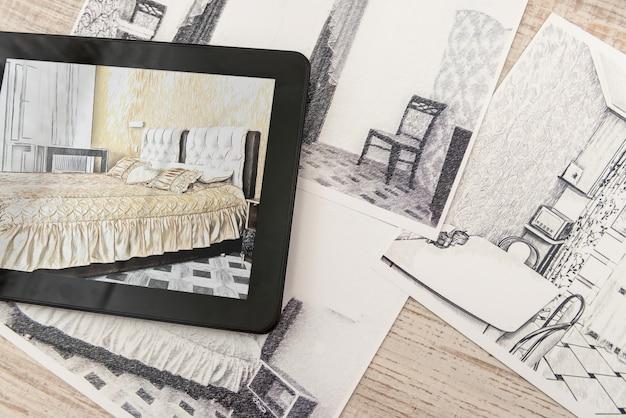 Tablet che mostra i piani della camera da letto nella stanza finita. appartamento moderno. disegno tecnico. interior design per la casa, schizzo