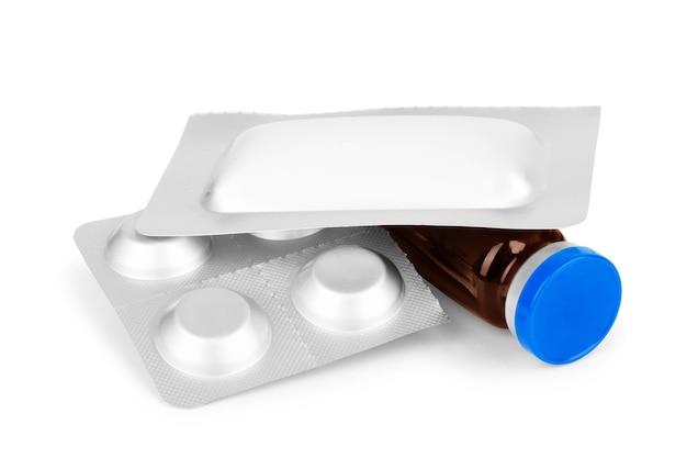 Compresse e capsule, bottiglia bianca per compresse, pillole di medicina farmaceutica