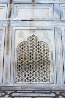 Taj mahal agra india. sfondo del modello. arco - stile arabo. bellissimo muro.