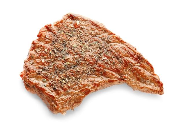 Gustosa bistecca alla griglia su bianco