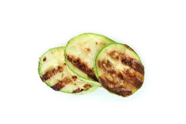 Gustose zucchine grigliate isolate su bianco