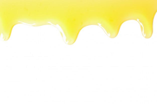 Gocciolatura saporita del miele isolata