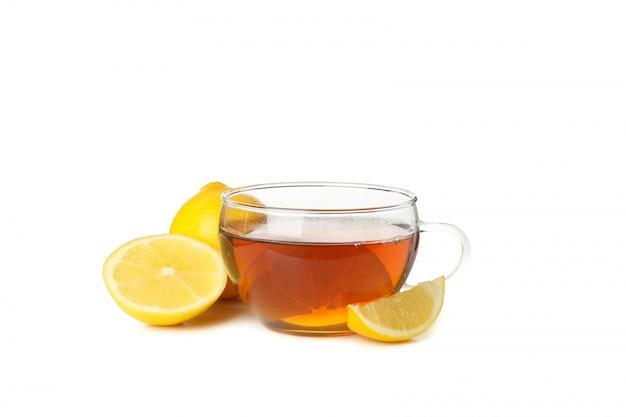Fette del limone e del tè isolate