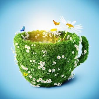 Tazza da tè con erba e camomilla