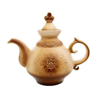 Teiera. teiera in ceramica isolata su superficie bianca. bollitore in ceramica con motivo.