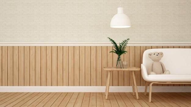 L'orsacchiotto riguarda il sofà in salone o la caffetteria - rappresentazione 3d