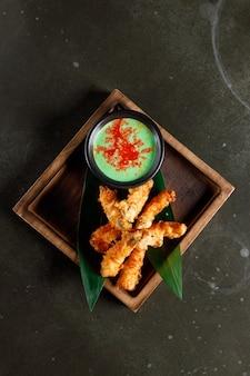 Gamberoni in tempura con maionese al wasabi