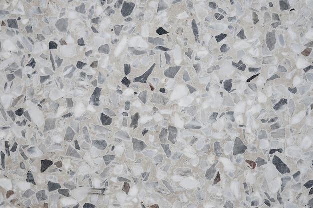 Pavimento in pietra lucidata terrazzo e motivo a parete e superficie in marmo e pietra granitica