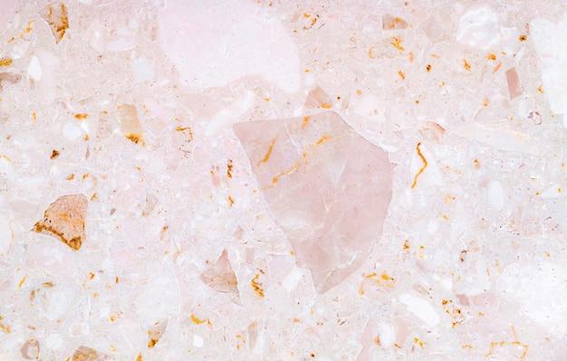 Sfondo texture terrazzo. una sorta di trama di pietra rosa marmo.