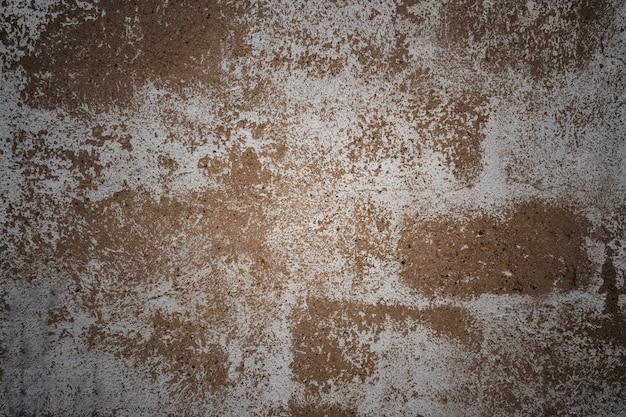 Testur muro di cemento grigio con intonaco bianco