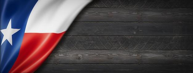 Bandiera del texas sulla bandiera della parete di legno nero, stati uniti d'america. illustrazione 3d