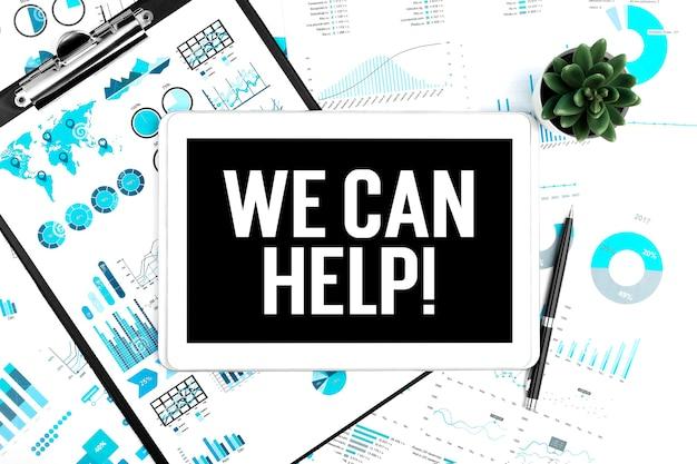 Testo possiamo aiutare su tablet. appunti, penna, pianta e grafici. concetto di affari. disposizione piatta.