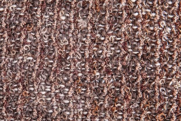 Fondo materico di tessuto melange con filo di lurex