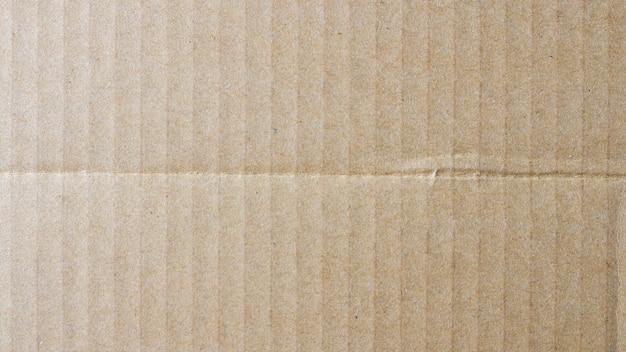 Scatola di carta marrone del fondo di struttura