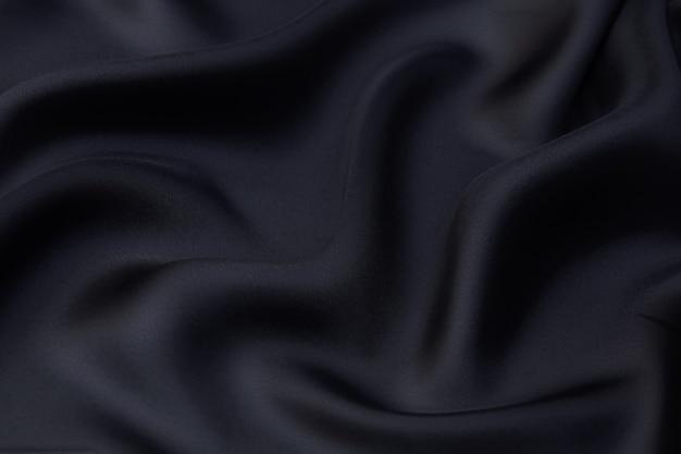 Texture, sfondo, pattern. tessuto in rayon nero per la sartoria.