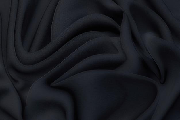 Trama, sfondo, motivo. tessuto in rayon nero per sartoria.