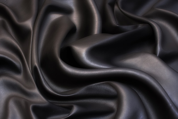 Trama, sfondo, motivo. tessuto sintetico grigio per cucire vestiti. finta pelle.