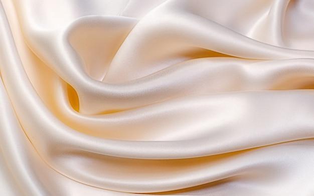 Trama, sfondo, motivo. tessuto di seta beige chiaro per cucire vestiti. crêpe de chine