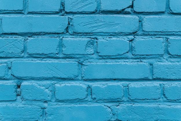 Texture di un muro di mattoni blu di una casa.