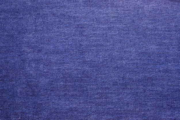 Trama del tessuto dei jeans blu da vicino