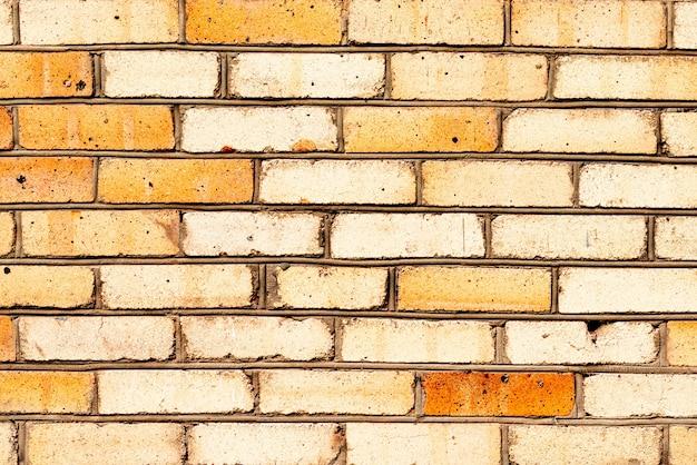 Texture, mattoni, muro, sfondo. texture di mattoni con graffi e crepe