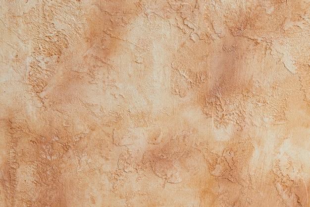 Struttura di colore beige del cemento, cemento del fondo con i divorzi