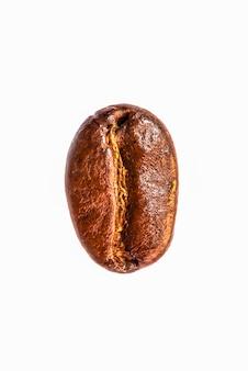 Struttura dei chicchi di caffè sulla priorità bassa di bianco dell'isolato