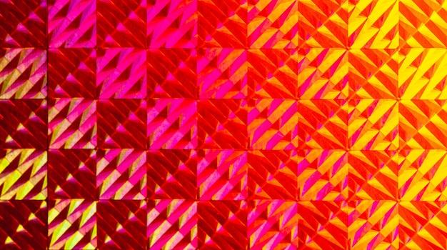 Texture di lamina colorata con effetto olografico. natale, capodanno, vacanze, festival, sfondo di carnevale