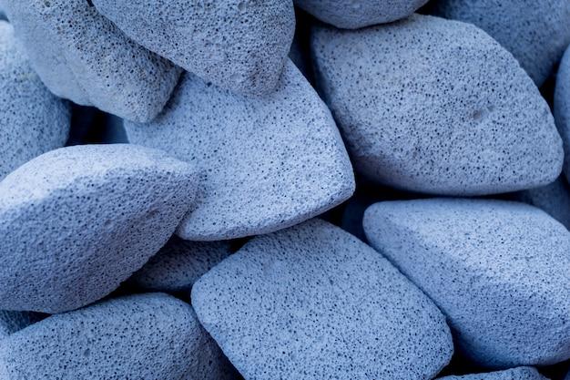 Texture di pietre pomice colorate per la cura dei piedi.