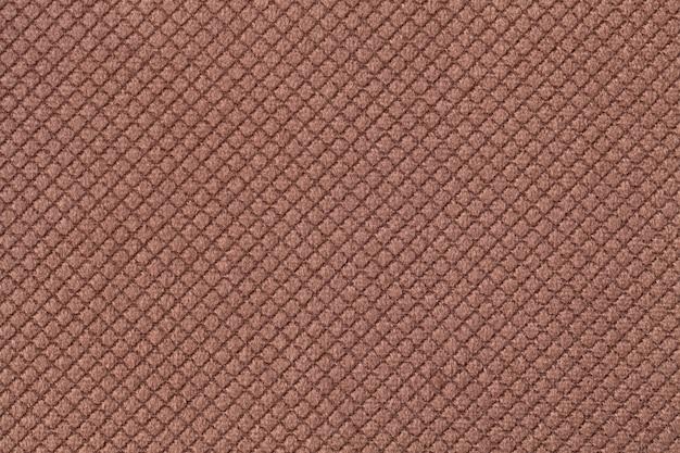 Texture di sfondo tessuto soffice marrone scuro con motivo romboidale, macro.