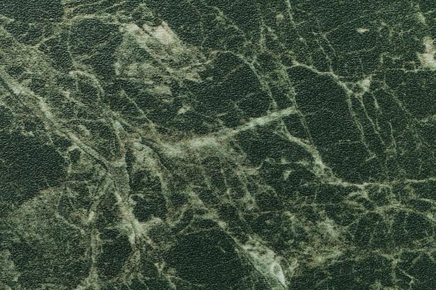 Texture di marmo verde scuro per il piano del tavolo con linee di oliva di un motivo
