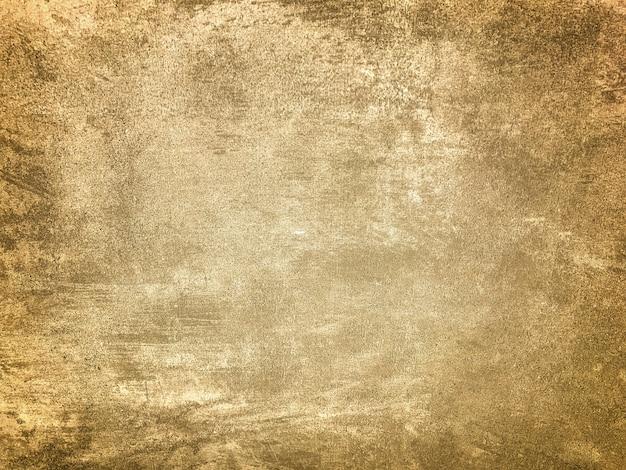 Intonaco beige chiaro decorativo di struttura che imita il vecchio muro scrostato con vignetta scura