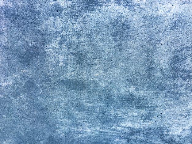 Texture intonaco decorativo blu navy imitando il vecchio muro scrostato. fondo di pietra incrinato obsoleto con il modello. struttura del muro di cemento.