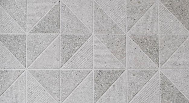 Texture di piastrelle decorative che formano triangoli