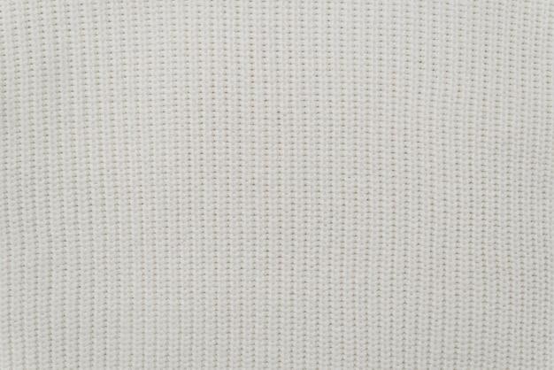 Trama del tessuto di un caldo maglione bianco