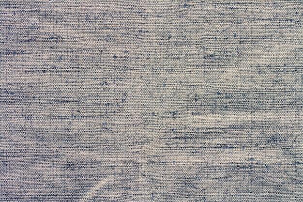 La trama del tessuto con punti testurizzati