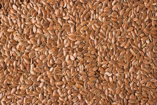 Texture di semi di lino ravvicinati, spezie o condimenti come sfondo