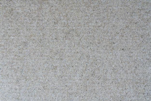 Texture da foglio di cartone marrone chiaro riciclato. vista dettagliata in primo piano
