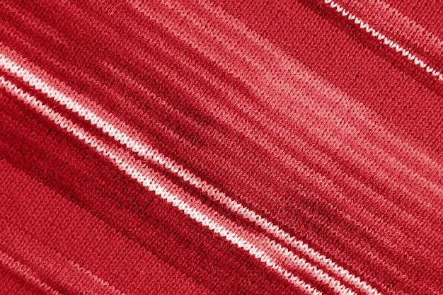 Tessitura di tessuto di lana lavorato a maglia di alpaca a strisce rosse sfumate per sfondo astratto