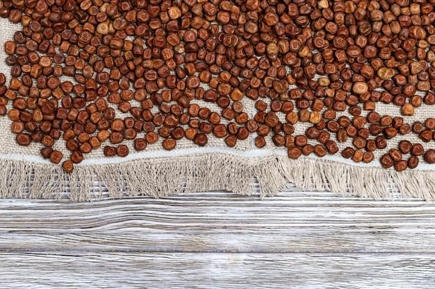 Piselli grigi di struttura. piccoli chicchi di semi di fagioli di legumi