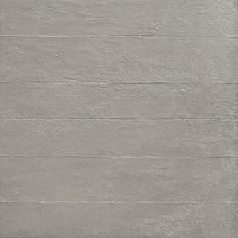 Struttura del pavimento e del muro di cemento grigio