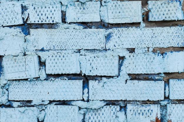 Struttura del muro di mattoni blu-chiaro, superficie strutturata. sfondo di mattoni. muro di mattoni blu