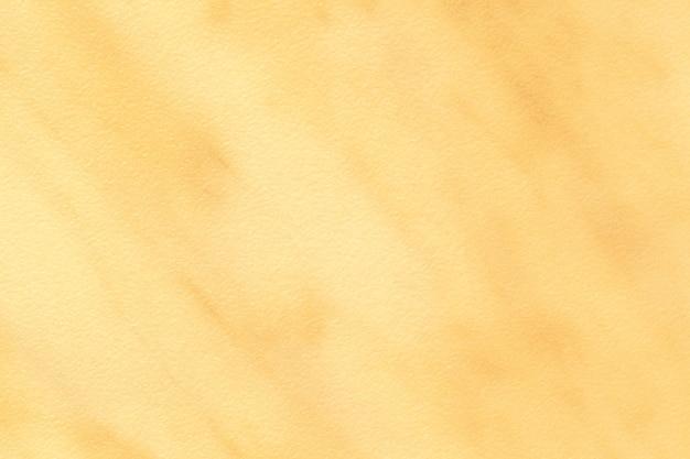 Texture di marmo dorato chiaro con motivo giallo, sfondo macro. sfondo astratto pietra ocra.