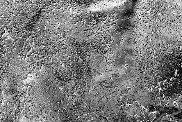 Texture di una parete metallica con crepe e graffi sullo sfondo