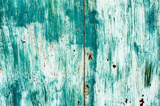 Trama di un muro di metallo con crepe e graffi che possono essere utilizzati come sfondo