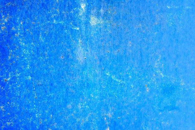 Texture di una parete metallica con crepe e graffi