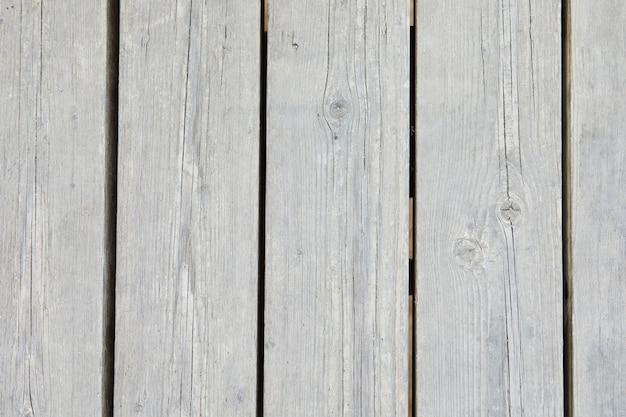 Texture di legno naturale di specie leggere da tavole verticali, sfondo.