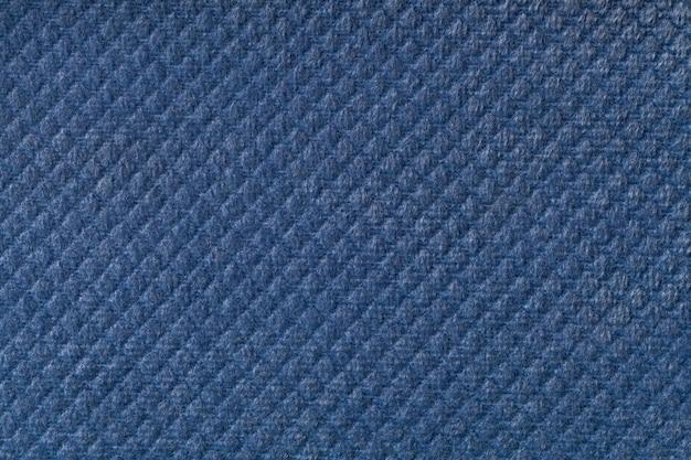 Texture di sfondo tessuto lanuginoso blu navy con effetto romboidale, macro.
