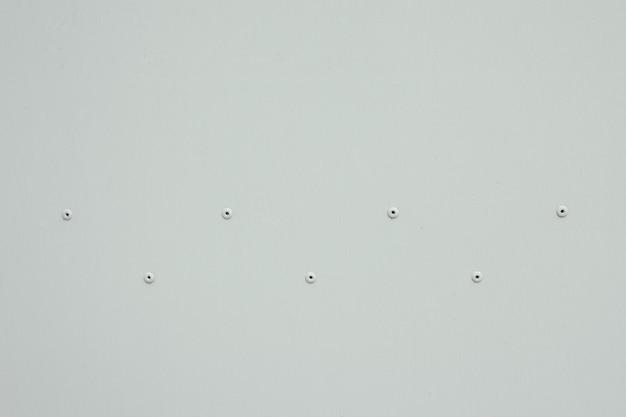 Texture della vecchia superficie in alluminio con rivetti, corrosione, graffi e ammaccature