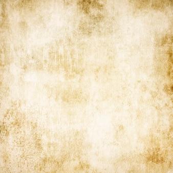 Texture di vecchia carta vintage beige per uno sfondo con un posto per il testo